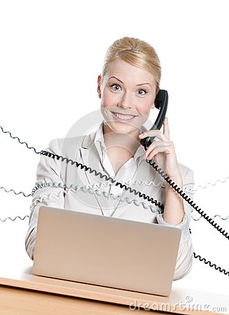 Businesswoman tied with phone cord