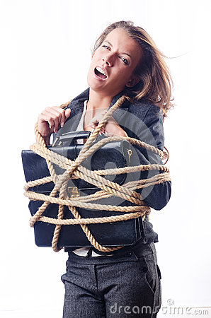 Businesswoman tied with rope