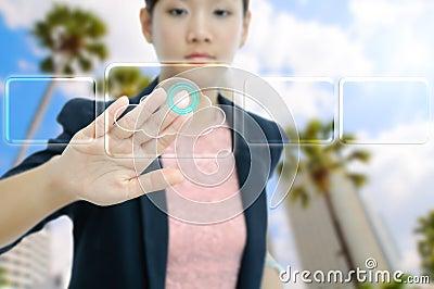 Businesswoman touch the virtual cloud button