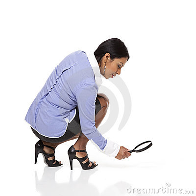 Businesswoman - tracking with magnifying glass