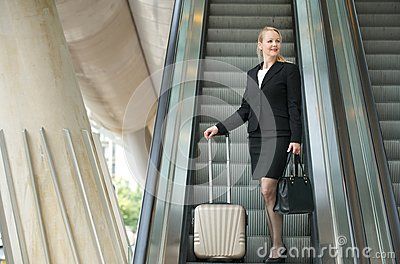 Businesswoman traveling with bags