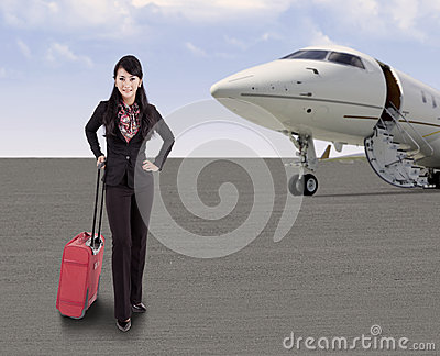 Businesswoman travelling with airplane