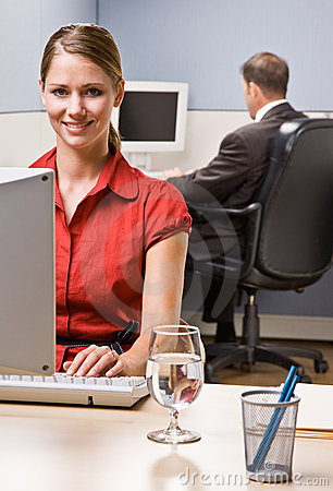 Businesswoman typing on computer at desk