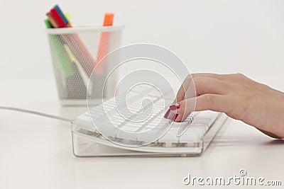 Businesswoman typing keyboard