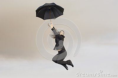 Businesswoman With An Umbrella In Midair