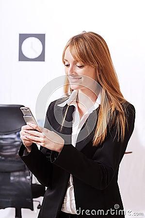 Businesswoman uses telephon