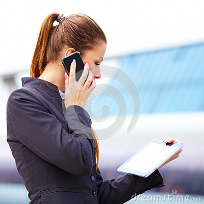 Businesswoman using digital tablet and mobile