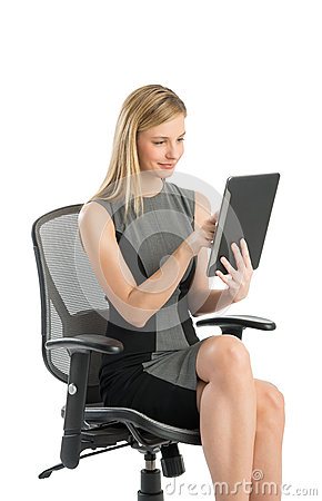 Businesswoman Using Digital Tablet While Sitting On Office Chair