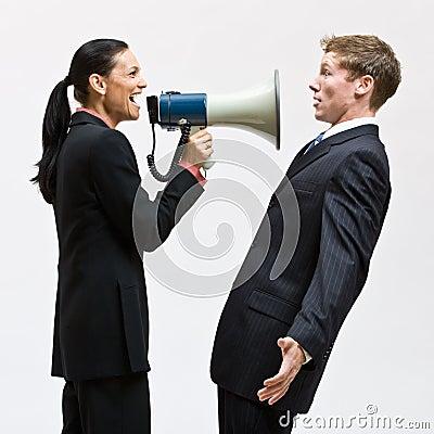 Businesswoman using megaphone