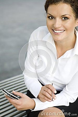 Businesswoman using palmtop