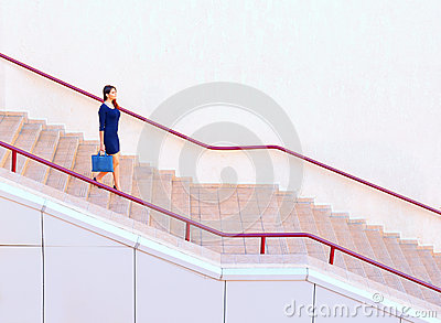 Businesswoman walking down stairs