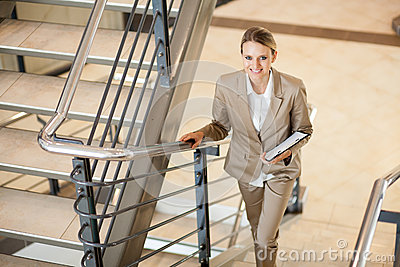 Businesswoman walking stairs