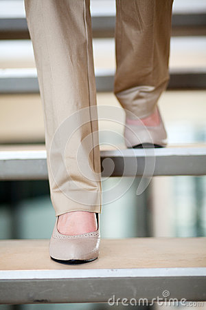 Businesswoman walking stairs