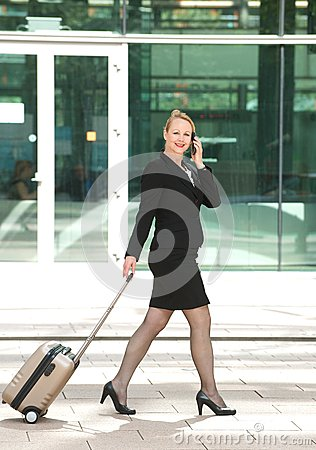 Businesswoman walking and talking in the city