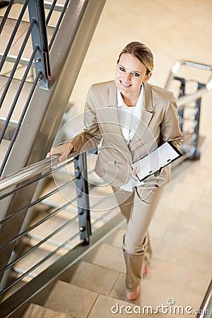 Businesswoman walking up stairs