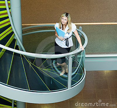 Businesswoman walking up stairs in office