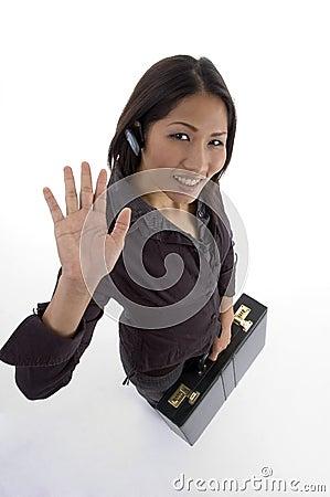 Businesswoman waving hand