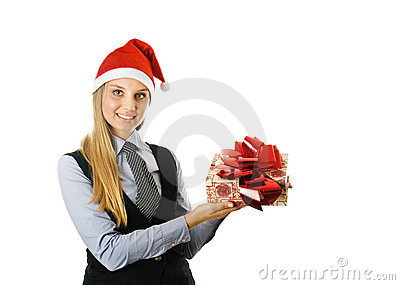 Businesswoman wearing a santa hat with a gift