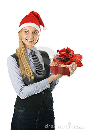 Businesswoman wearing a santa s hat with a gift
