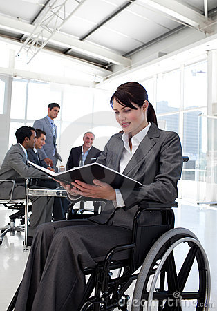 Businesswoman in a wheelchair reading a report