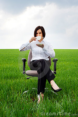 Businesswoman with white cup of coffee