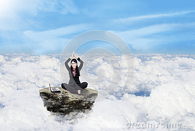 Businesswoman working above clouds