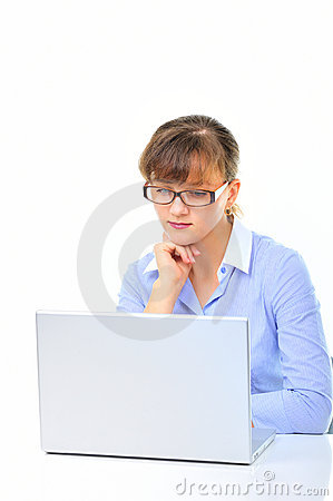 Businesswoman is working on laptop