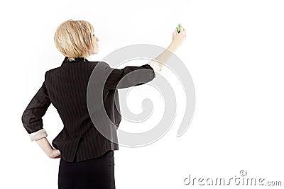Businesswoman writing on board