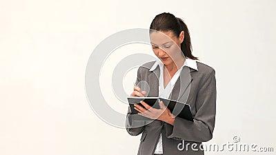 Businesswoman writing on her notebok Stock Photo
