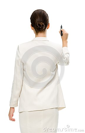 Businesswoman writing on imaginary screen