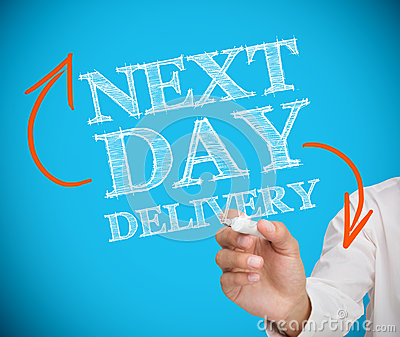Businesswoman writing next day delivery