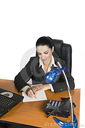 Businesswoman writing on a page in office