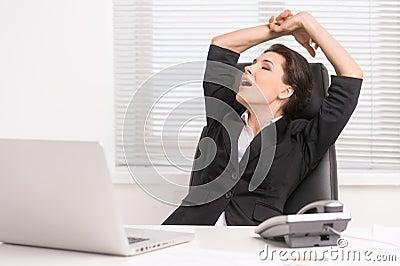 Businesswoman yawning.