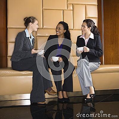 Businesswomen drinking coffee.