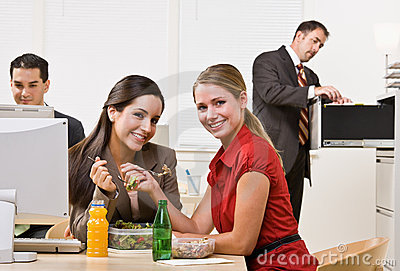 Businesswomen eating salad for lunch