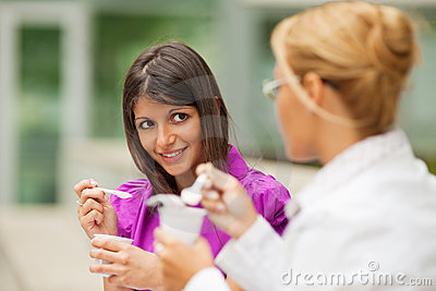 Businesswomen eating yogurt