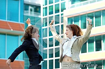 Businesswomen Jump For Joy