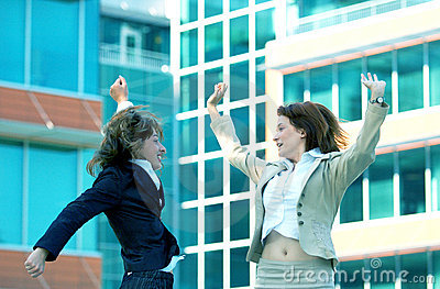 Businesswomen Jump For Joy Blue Tint