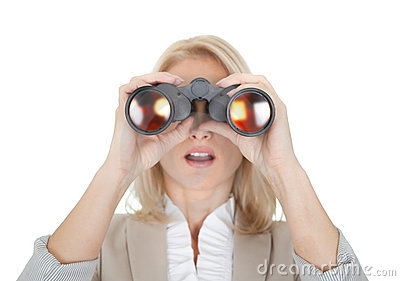 Businesswomen looking through binoculars