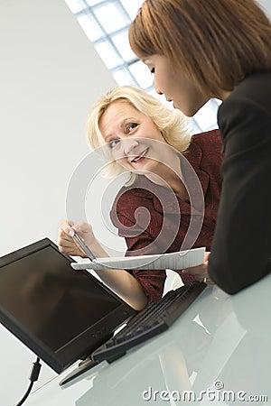 Businesswomen negotiating