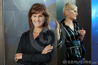 Businesswomen in office lobby