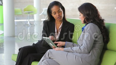 Businesswomen On Sofa And Using Digital Tablet stock footage
