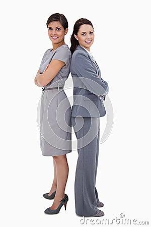 Businesswomen standing back on back