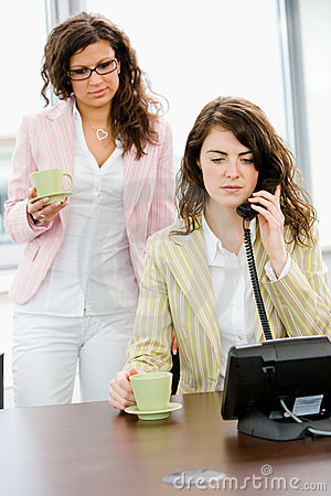 Businesswomen talking on phone