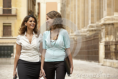 Businesswomen Walking Through Town