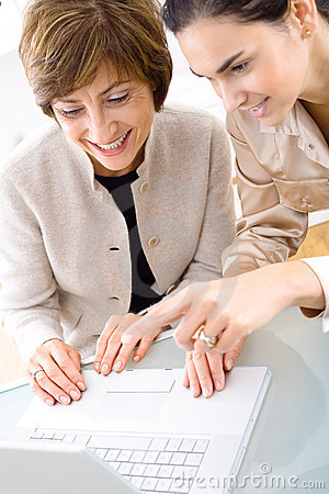 Businesswomen working on laptop