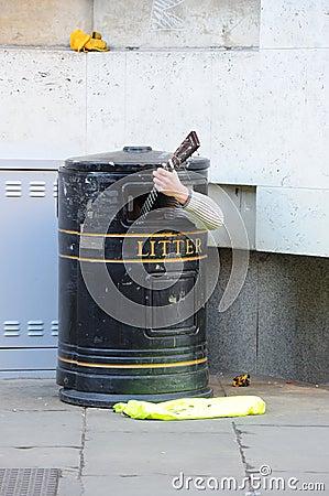Busker In Bin Editorial Stock Image
