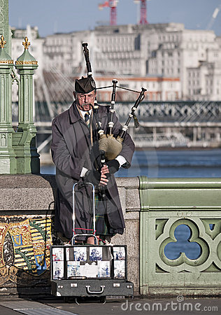 Busker musician on Westminster Bridge, London, UK Editorial Image