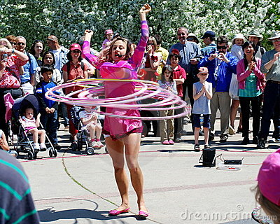 Busker performs hula hoop routine Editorial Stock Photo