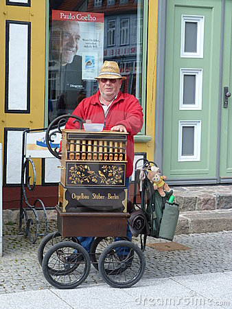 Busker playing barrel organ Editorial Image